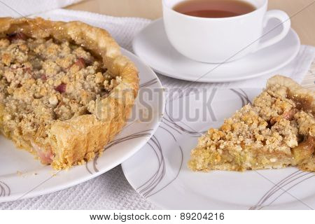 Tea Served With Traditional British Rhubarb Crumble Tart