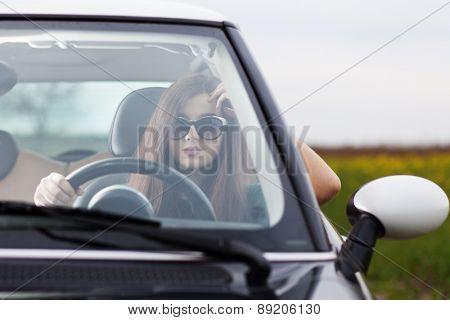 Young beuatiful woman driving a car.