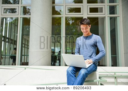 Asian college student sitting at college