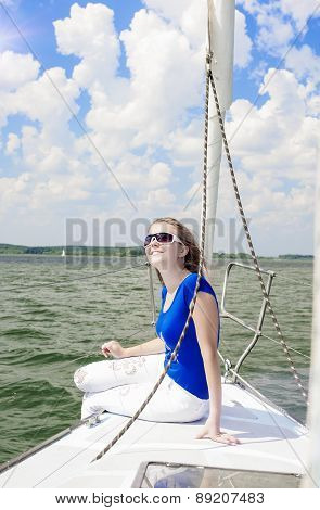 Sexy Cute Smiling Positive Caucasian Woman Relaxing On White Yacht On Upper Deck