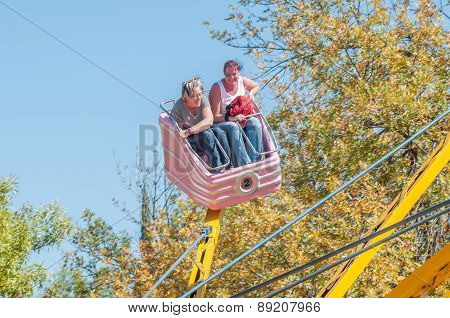 Visitors Enjoying The Amusement Park At The Annual Bloem Show