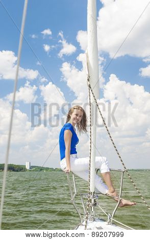 Travelling Concepts: Sensual Caucasian Woman Sailing On Yacht Outdoors