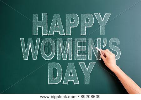 writing happy womens day on blackboard