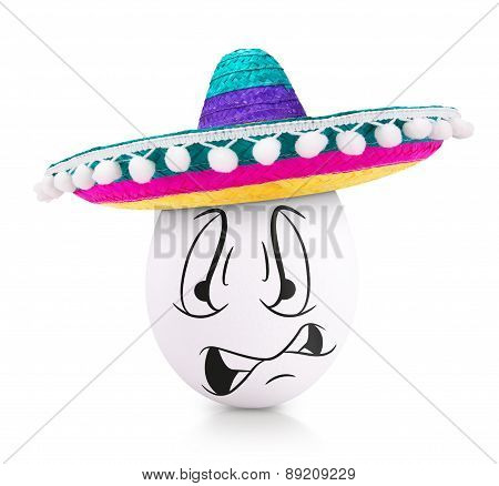 Concept white egg with angry face in a sombrero