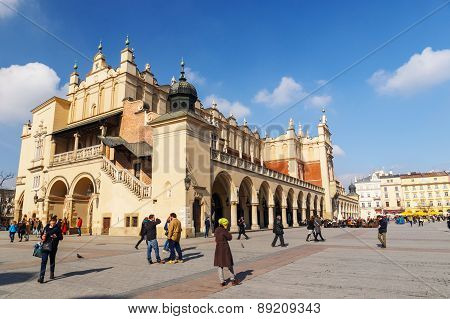 KRAKOW POLAND - March 07 2015: Tourists enjoying an spring day in The Grand Central Square