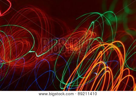 Colorful Light Rays Drawing The Abstract Patterns In The Dark