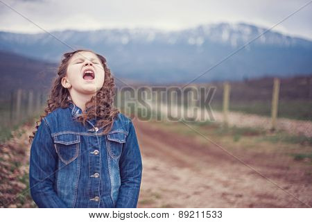 Little girl in nature yelling