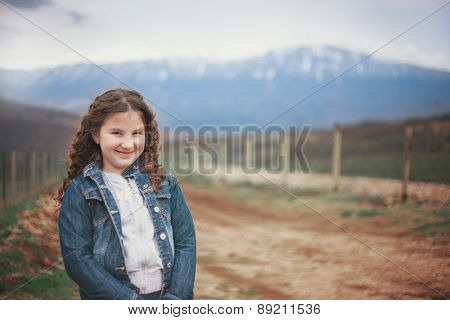 Smiling young girl in mountain region