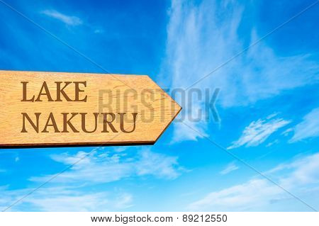 Wooden arrow sign pointing destination LAKE NAKURU