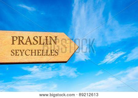 Wooden arrow sign pointing destination PRASLIN SEYCHELLES