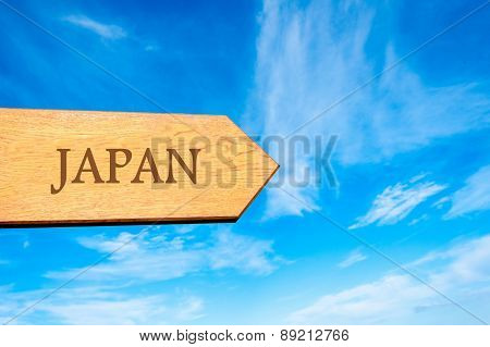 Wooden arrow sign pointing destination JAPAN