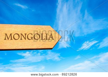 Wooden arrow sign pointing destination MONGOLIA