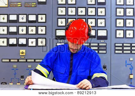 Engineer working in the industrial interior