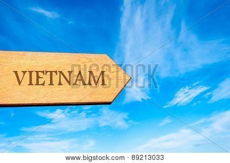 Wooden arrow sign pointing destination VIETNAM