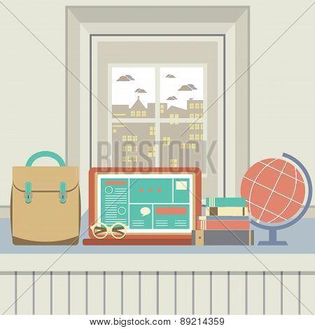 Laptop, Books, Eyeglasses And Desk Globe On Windowsill.
