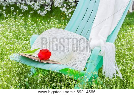 Deckchair, Tulip. Scarf And Hat In The Garden