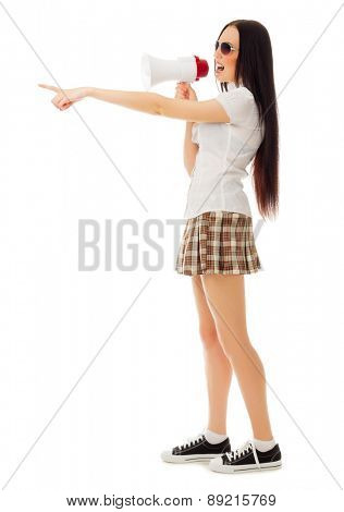 Girl in plaid skirt with sunglasses and megaphone isolated
