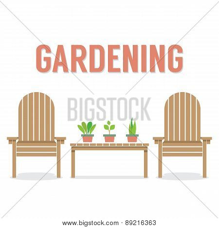 Wooden Garden Chairs And Pot Plant On Table.