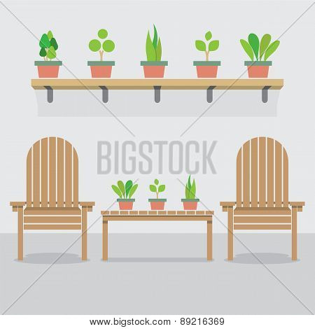 Wooden Garden Chairs And Pot Plants.