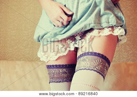 Tender girl in nightdress and hose with copyspace. Toned coloriz