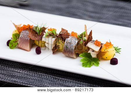 Salted and marinated herring appetizer