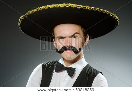 Smiling mexican with sombrero isolated on white