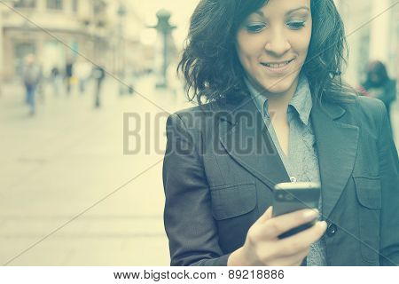 Woman With Cellphone Walking On Street