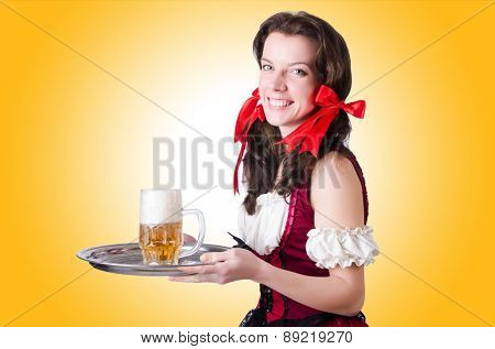 Bavarian girl with tray on white