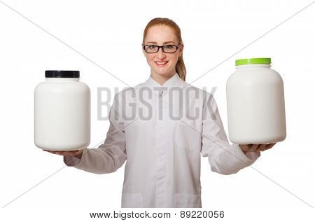 Young female doctor holding jar of protein isolated on white