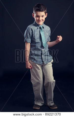 Young Boy In Tie Making Fist