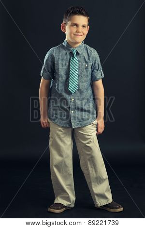 Young Boy In Shirt Tie And Khaki Pants