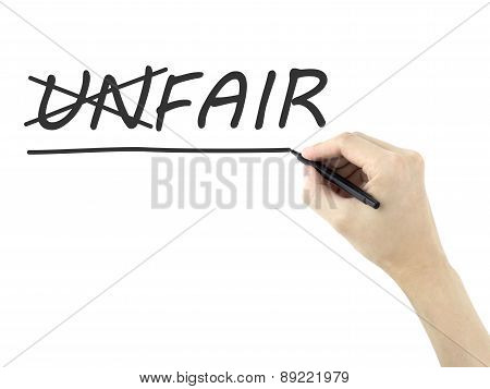 Man's Hand Changing The Word Unfair Into Fair