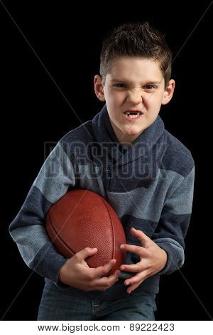 Boy Holidng Football And Making Scary Face
