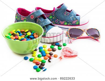 colorful children's stuff and sweets on a white background