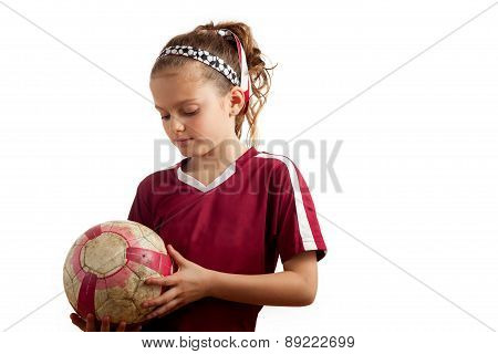 Girl Holidng Soccer Ball Looking Down