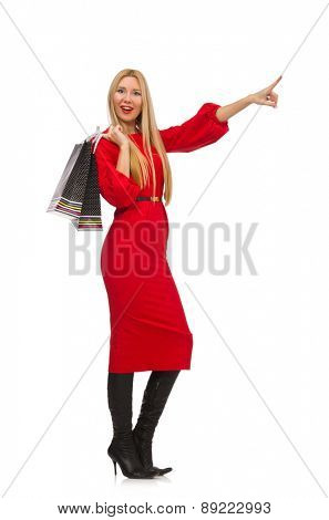 Beautiful woman in red long dress isolated on white