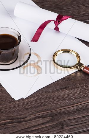 Coffee Cup, Paper Sheets And Detective Magnifying Glass