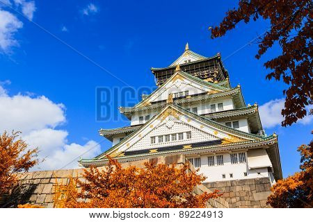 Osaka Castle in Osaka with autumn leaves, Japan.