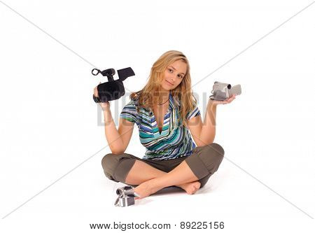 Studio shot of young blone woman with digital camcorder