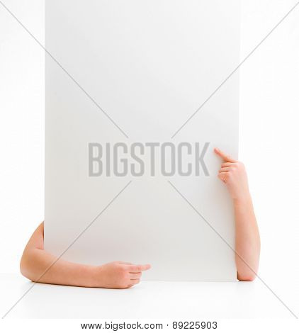 hands of a little girl holding a poster with space for text