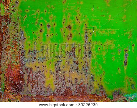 Rusty Painted Metal With Cracked Paint. Orange, Brown And Green Colors. Texture Grunge Background