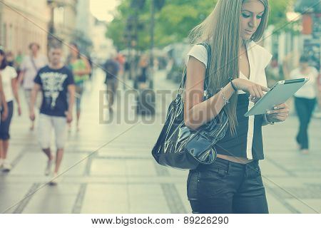 Young Business Woman With Tablet Computer Walking On Urban Street