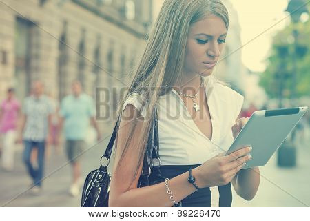 Business Woman With Tablet Computer Walking On Urban Street