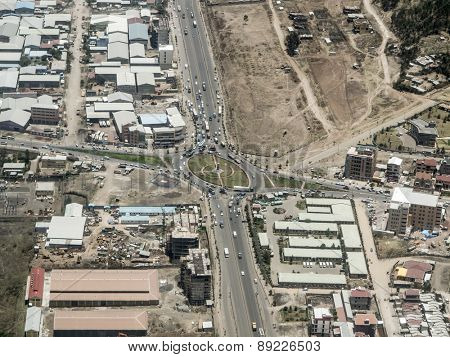 Aerial view of highway roundabout and buildings in Addis Ababa, Ethiopia from plane