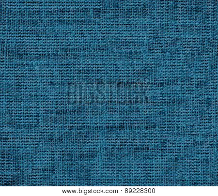 Blue sapphire color burlap texture background