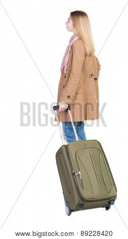 Back view of woman with suitcase looking up. Standing young girl. Rear view people collection.  backside view of person. Isolated over white background. The girl at the train station waiting for train