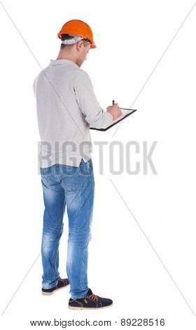 young engineer in a protective helmet with notepad in the hands of. girl  watching. Rear view people collection.  backside view of person.  Isolated over white background.