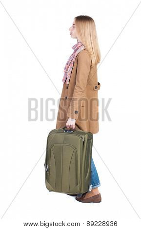 Back view of woman with suitcase looking up. Standing young girl. Rear view people collection.  backside view of person. Isolated over white background.