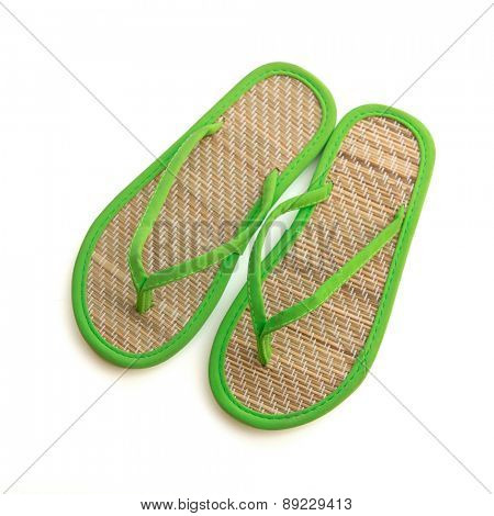 Pair of bamboo flip flops isolated on white