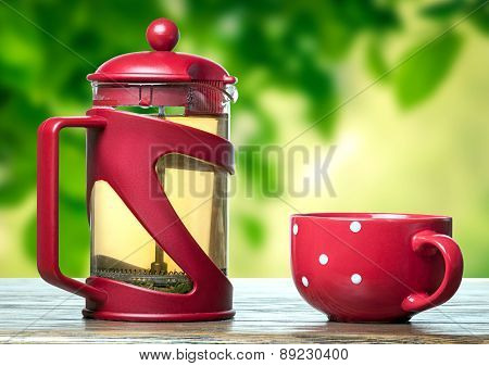 Red Teapot And Cup With Tea